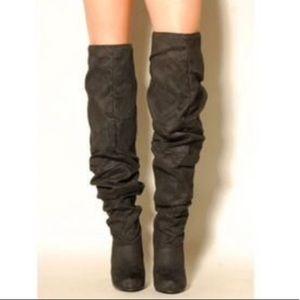 Micheal Antonio thigh high boots